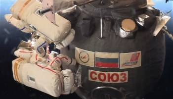 Cutting into Soyuz cover