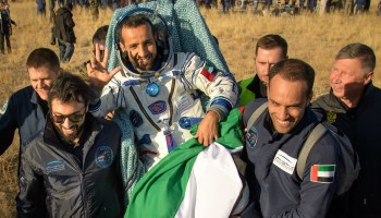 Three spacefliers, including first Emirati in orbit, return to Earth from space station