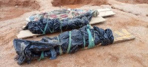 The dead bodies at the mining scene