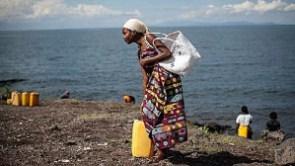 Residents walk to lake kivu for water in DRC