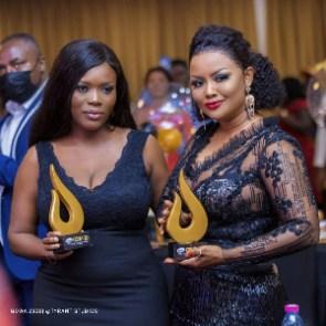 Delay and Nana Ama McBrown posing with their awards