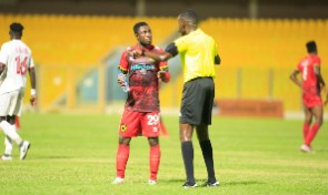 Emmanuel Gyamfi with a referee during a GPL game