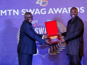 Sports Minister Isaac Asiamah presenting the award to an official of StarTimes