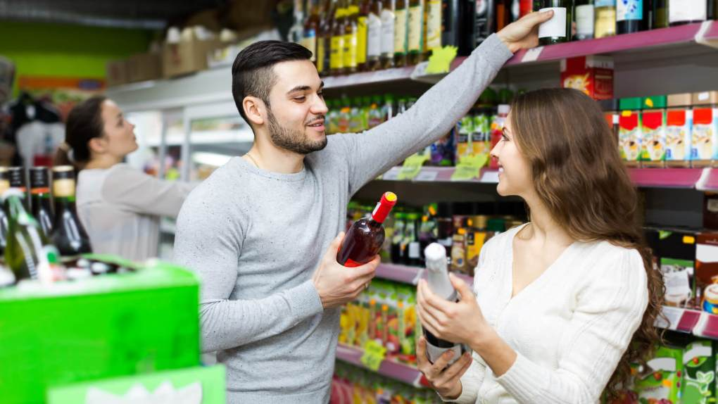couple grocery shopping for alcohol