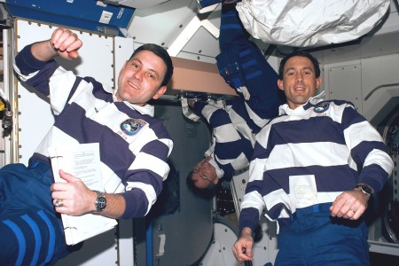 Astronaut James H. Newman (right) wears the Timex Datalink 50 model 70502 on STS-88