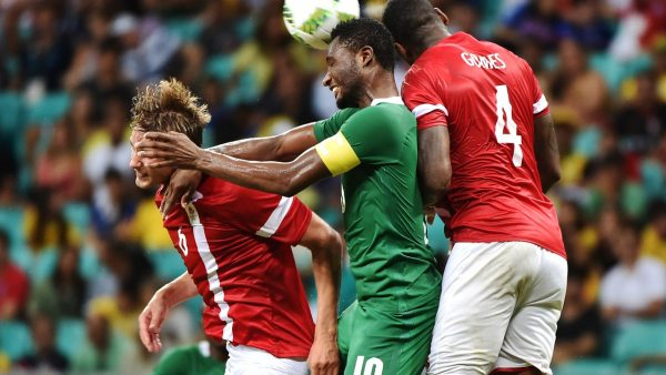 John Obi Mikel (C) of Nigeria heads for the ball with Andreas Maxso (L) and Edigerson Gomes (R) of Denmark during the Rio 2016 Olympic Games men's quarter-final football match Nigeria vs Denmark, at the Arena Fonte Nova Stadium in Salvador, Brazil on August 13, 2016.  NELSON ALMEIDA / AFP