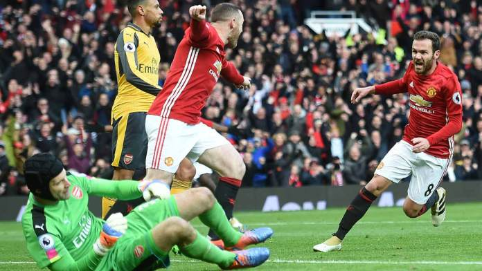 Manchester United's Spanish midfielder Juan Mata (R) celebrates scoring his team's first goal with Manchester United's English striker Wayne Rooney (C) during the English Premier League football match between Manchester United and Arsenal at Old Trafford in Manchester, north west England, on November 19, 2016. Paul ELLIS / AFP