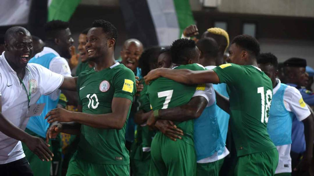 Nigerian players celebrate a goal during the 2018 FIFA World Cup African zone group B qualifying football match between Nigeria and Algeria at the Akwa Ibom State Stadium in Uyo on November 12, 2016.  PIUS UTOMI EKPEI / AFP