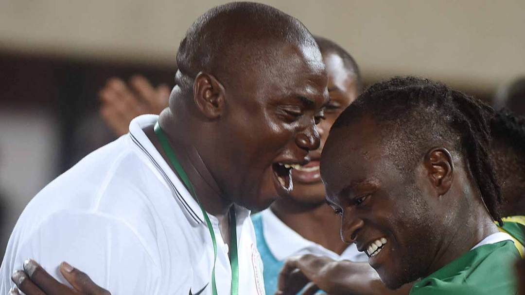 Nigeria's forward Victor Moses (R) celebrates with an unidentified member of the Nigerian Football Federation after scoring a goal during the 2018 FIFA World Cup African zone group B qualifying football match between Nigeria and Algeria at the Akwa Ibom State Stadium in Uyo on November 12, 2016. PIUS UTOMI EKPEI / AFP