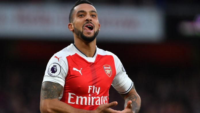 Arsenal's English midfielder Theo Walcott celebrates after scoring their second goal during the English Premier League football match between Arsenal and Bournemouth at the Emirates Stadium in London on November 27, 2016.  / AFP PHOTO / Ben STANSALL / RESTRICTED TO EDITORIAL USE. No use with unauthorized audio, video, data, fixture lists, club/league logos or 'live' services. Online in-match use limited to 75 images, no video emulation. No use in betting, games or single club/league/player publications.  /