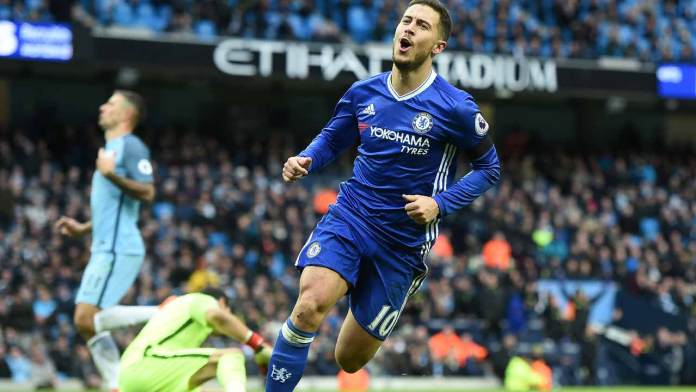 Chelsea's Belgian midfielder Eden Hazard celebrates scoring his team's third goal during the English Premier League football match between Manchester City and Chelsea at the Etihad Stadium in Manchester, north west England, on December 3, 2016.  Paul ELLIS / AFP