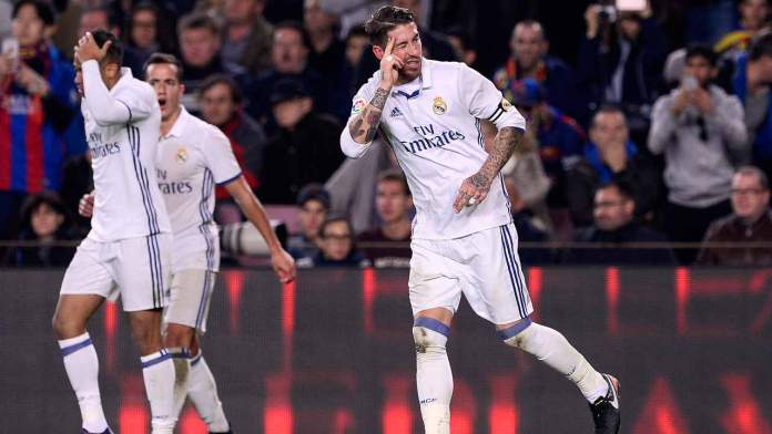 Real Madrid's defender Sergio Ramos (R) celebrates after scoring the equalizer during the Spanish league football match FC Barcelona vs Real Madrid CF at the Camp Nou stadium in Barcelona on December 3, 2016.  JOSEP LAGO / AFP