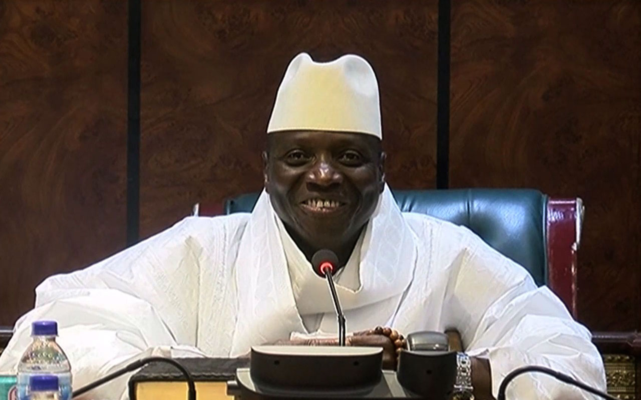 """An image grab taken on December 3, 2016 from a video of the Gambia and Television Services (GRTS) broadcasted on December 2, 2016, in Banjul shows outgoing Gambian President Yahya Jammeh speaking during a press conference after being defeated during the presidential election. Jammeh conceded defeat to opposition leader Adama Barrow on December 2, 2016 accepting that Gambians had """"decided that I should take the backseat"""". The Gambia's President-elect Adama Barrow was to hold talks with his coalition the day after to plot his transition to power, following a shock election victory that ended the 22-year rule of Yahya Jammeh. / AFP PHOTO / GRTS - Gambia Radio and Television Services / Handout"""