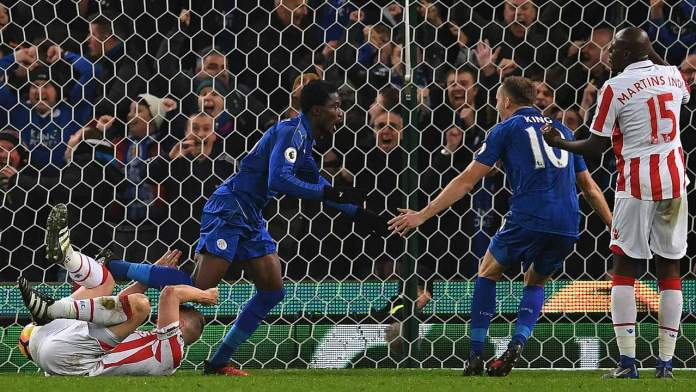 Leicester City's Ghanaian midfielder Daniel Amartey (2L) celebrates scoring his team's second goal during the English Premier League football match between Stoke City and Leicester City at the Bet365 Stadium in Stoke-on-Trent, central England on December 17, 2016.  Paul ELLIS / AFP
