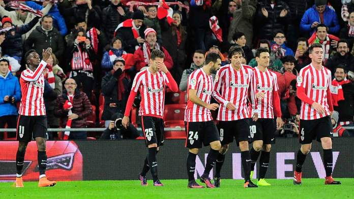 Athletic Bilbao's forward Inaki Williams Arthur (L) celebrates after scoring his team's second goal during the Spanish Copa del Rey (King's Cup) round of 16 first leg football match Athletic Club Bilbao VS FC Barcelona at the San Mames stadium in Bilbao on January 5, 2017.  ANDER GILLENEA / AFP