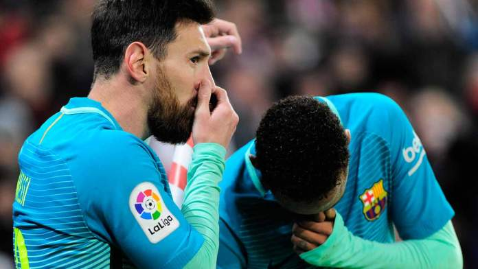 Barcelona's Argentinian forward Lionel Messi (L) and teammate Brazilian forward Neymar da Silva Santos Junior speak during the Spanish Copa del Rey (King's Cup) round of 16 first leg football match Athletic Club Bilbao vs FC Barcelona at the San Mames stadium in Bilbao on January 5, 2017.  ANDER GILLENEA / AFP