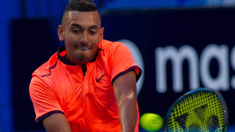 Nick Kyrgios of Australia hits a return against Feliciano Lopez of Spain during their second session men's singles match on day one of the Hopman Cup tennis tournament in Perth on January 1, 2017. TONY ASHBY / AFP