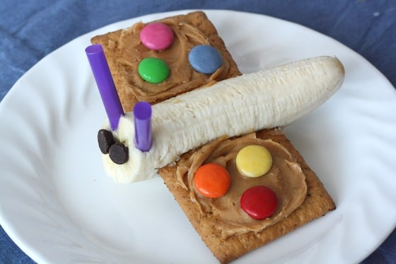 Butterfly snack made with banana for body and  graham crackers, peanut butter and smartie for wings