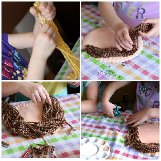 kids putting yarn hair on paper plate face craft