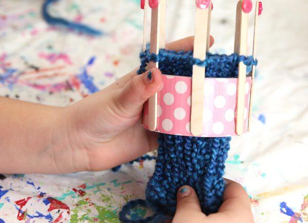 blue glove on duct tape loom