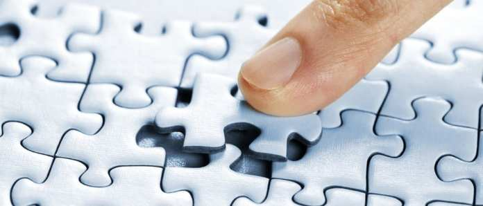 A final puzzle piece being inserted into it's place.