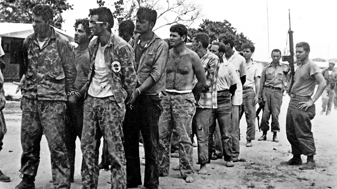 A group of Cuban counter-revolutionaries, members of Assault Brigade 2506, after their capture in the Bay of Pigs, Cuba. (Credit:  MIGUEL VINAS/AFP/Getty Images)