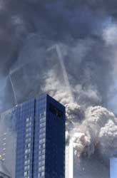 The South Tower of the World Trade Center collapses.