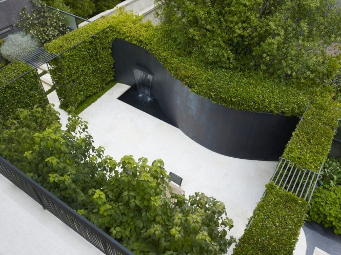Via ArteArchitecturalYou don't always have to stick to a straight sided yard, fashion a curved wall to throw off dimensions.