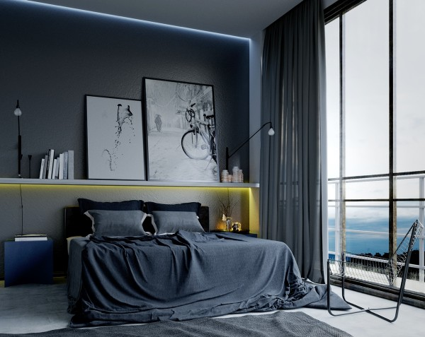 Cool grays and black and white artwork establish this bedroom as a creative retreat.