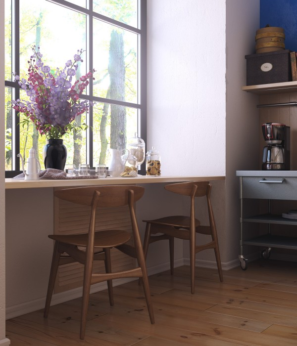 Rather than set up a bulky dining table, this small space uses a sunny and svelte breakfast bar design.