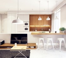 Wood elements are balanced well to lend a sense of visual weight and depth to the otherwise small apartment. The recessed kitchen counter is especially neat and cozy-looking, outfitted with vertical wood grain from top to bottom.