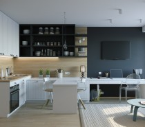 Designed for a young woman, this interior is defined by its smart layout and expertly framed zones. Within 26 square meters, the requirements included a kitchen that feels independent, a spacious wardrobe, and a workable office space. Here you can see the office taking up residence tucked beneath the television, and the transparent Louis Ghost Chair by Phillipe Starck ensures the view goes without obstruction.