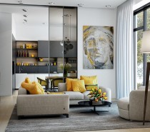 Let's begin our exploration of yellow decor with an especially strong example. This artistic home features smartly-arranged yellow accessories, a great way to spice up the gray sofa and open kitchen shelves. The painting ties the theme together.
