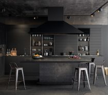 Almost all-resplendent in black, a few minor elements shine in chrome and wood. Textures do the talking in a matte table under, granite bench and black wood-panelled walls.