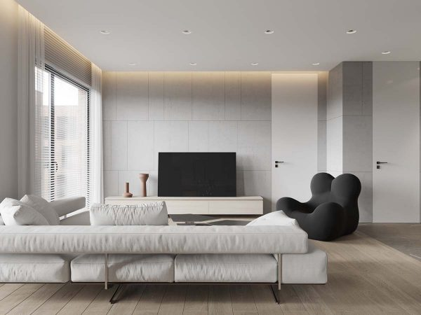With the white palette and large picture windows the living room feels quite spacious horizontally