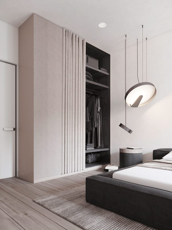 A Large Bedroom Pendant Light Hangs By The Bed, Beside A Smaller Version Of  Itself Strung Lower Over A Bedside Unit.