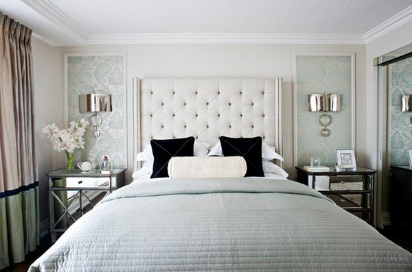 bedroom with mirrored bedside tables