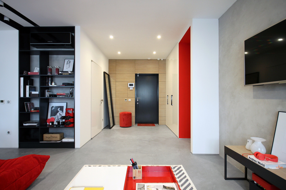 Chic Pops Of Red Bring Energy Into A Black And White Apartment