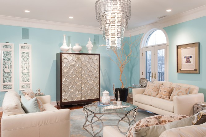 Tiffany Blue Bedroom With Sitting Area Featuring Trim Molding On Walls Framing Striped Loveseat Paired Patterned Slipper