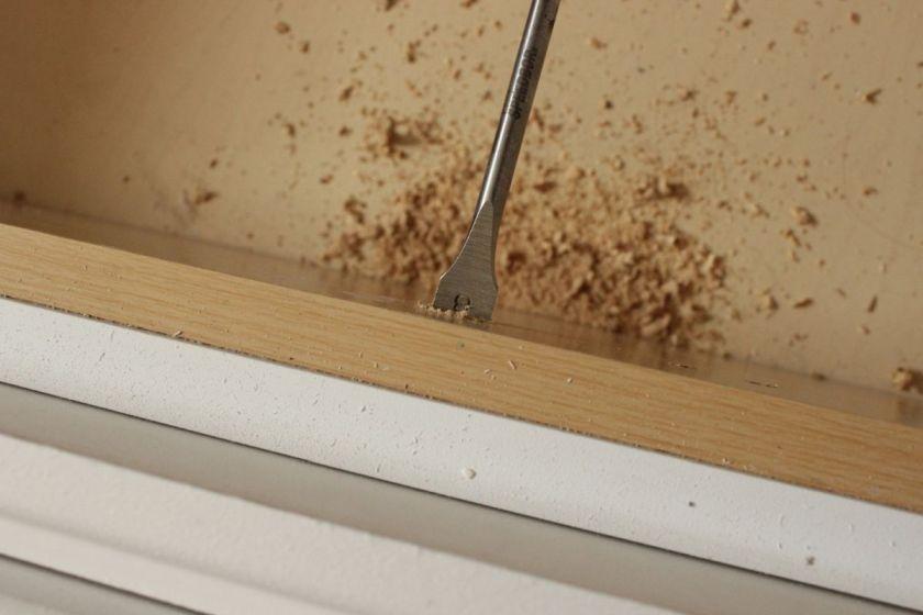 DIY Upgrade Bathroom Vanity- holding drill