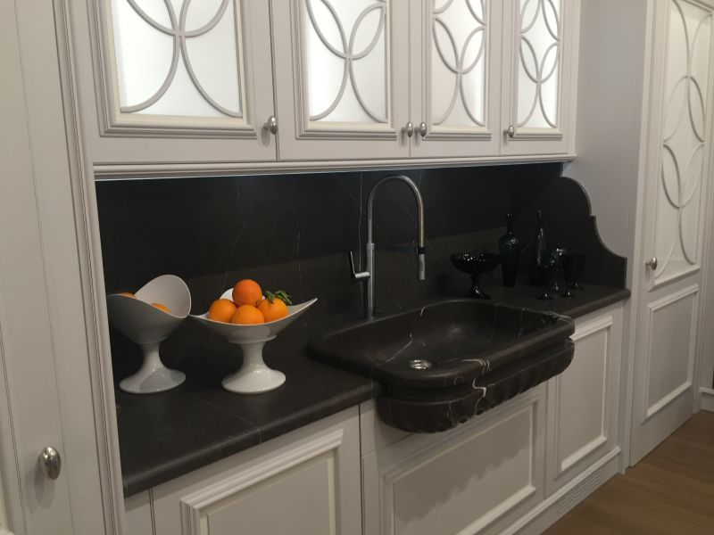 Black and white kitchenn design with marble countertop and backsplash