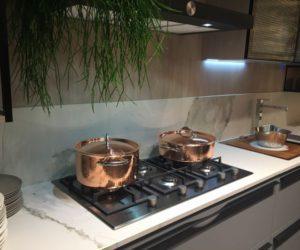 Copper pots and marble backsplash