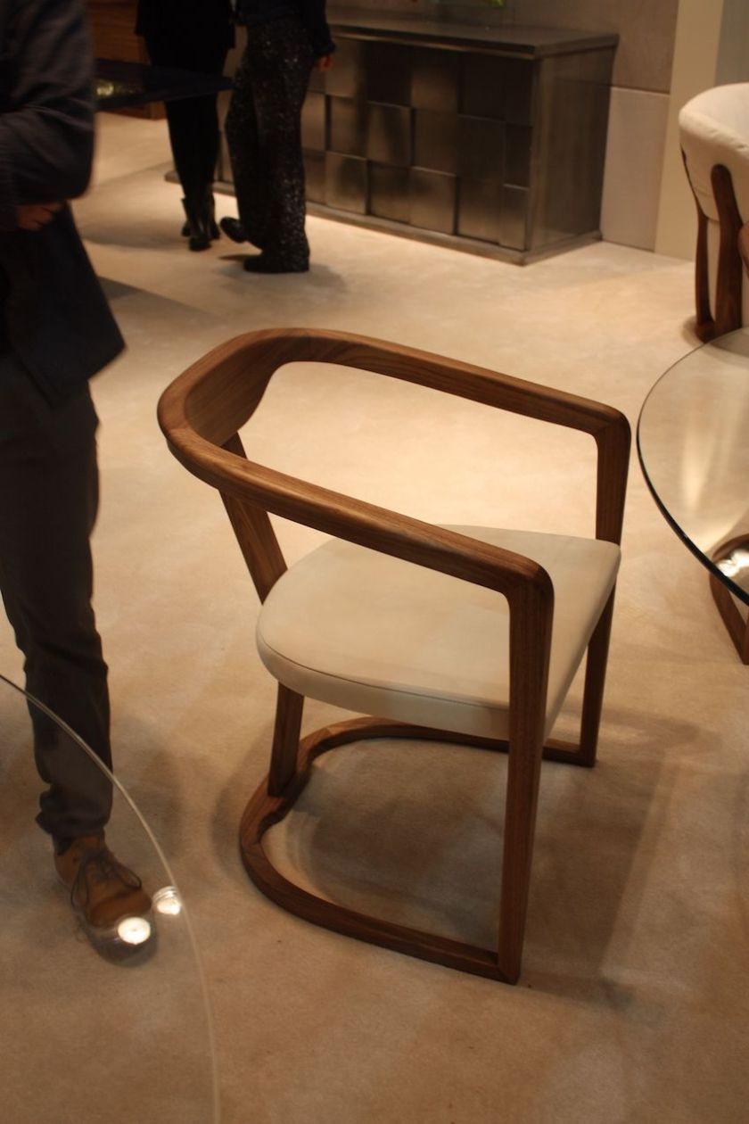 A modern dining chair with a touch of warmth, this elegant armchair design from KLAB is a great choice for round table.