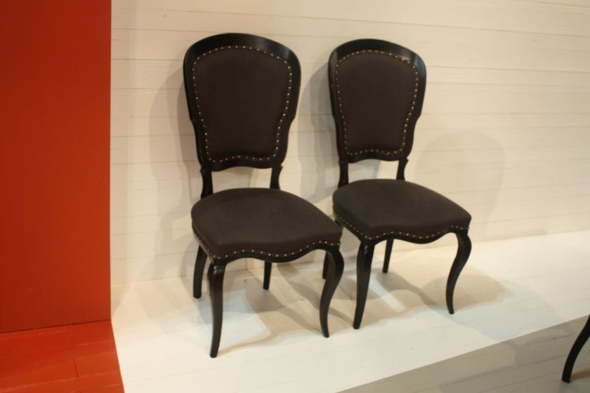 For thosewho like a more traditional style, these dining chairs byMarchetti are stately with an interesting shape. The graceful legs are particularly enticing.