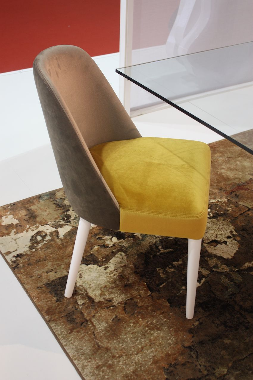 Two colors of suede upholstery increase the interest of this chair.