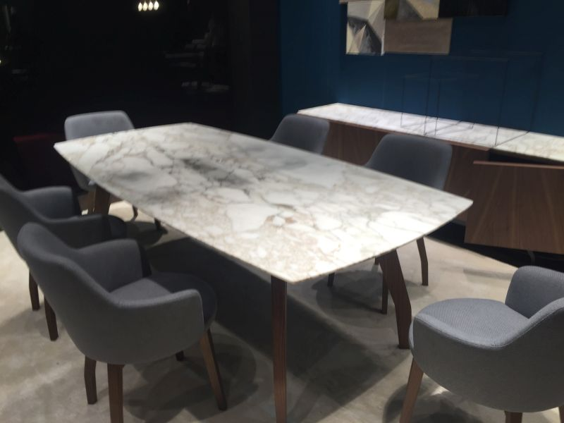 Rectangular dining table with round corners and marble