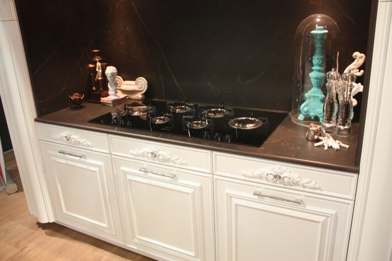 Traditional kitchen with black backsplash