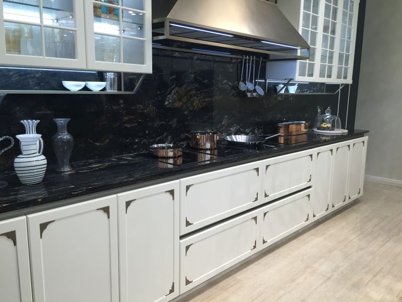 Traditional white kitchen with a black marble backsplash