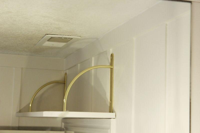 shelf from the bathroom vanity mirror