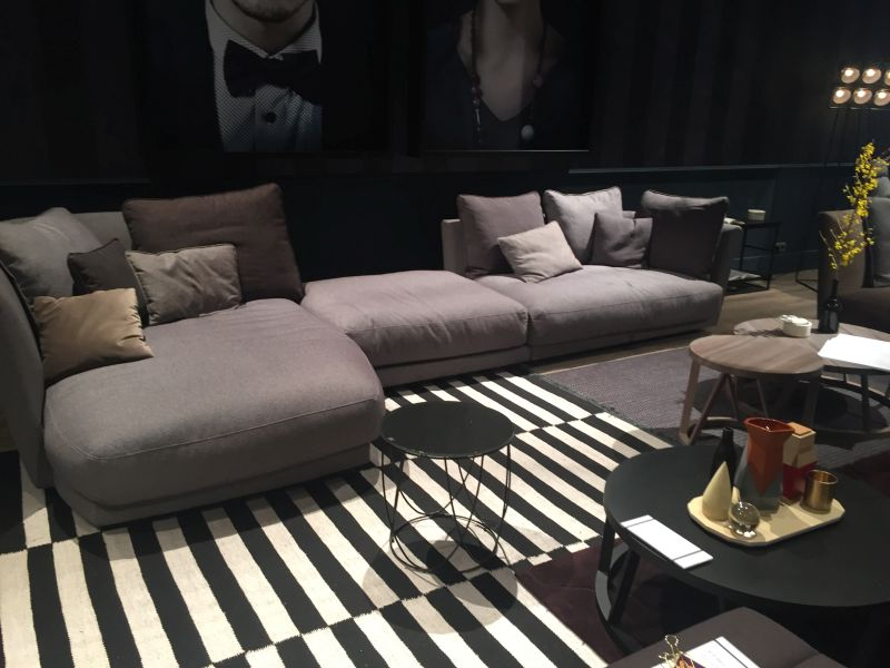Black and white striped rug with grey sofa